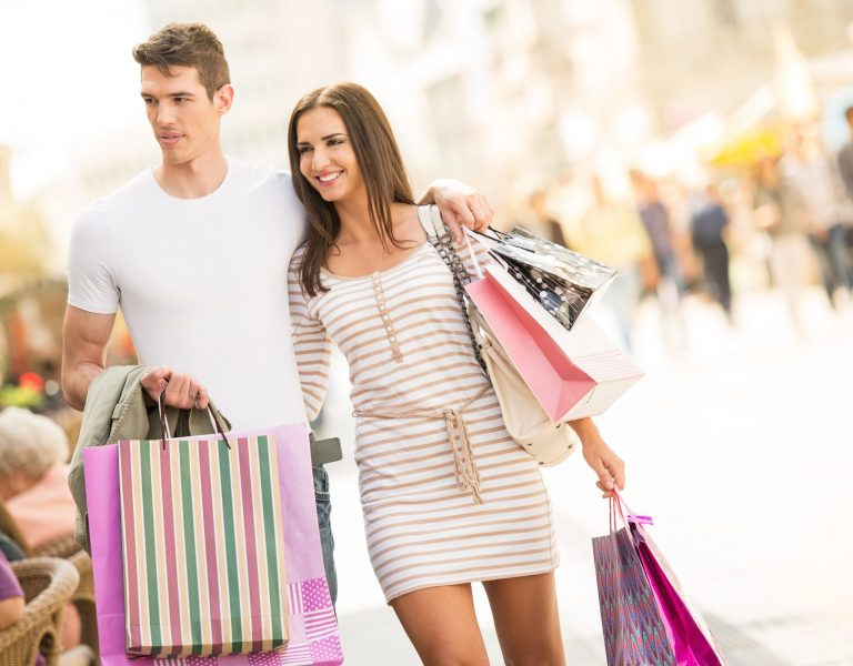 Couple-Shopping-on-Street-with-Bags-Dollarphotoclub_71628414